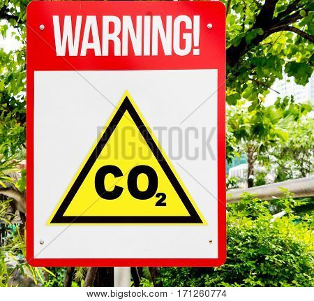 CO2 red Warning sign in forest background