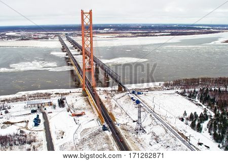The longest cable-stayed bridge over the river ice snow winter Siberia spring