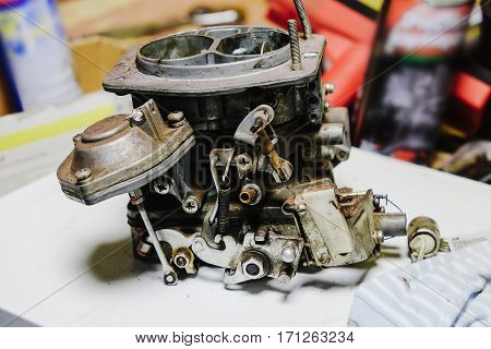 disassembled the carburetor of the car is on the table