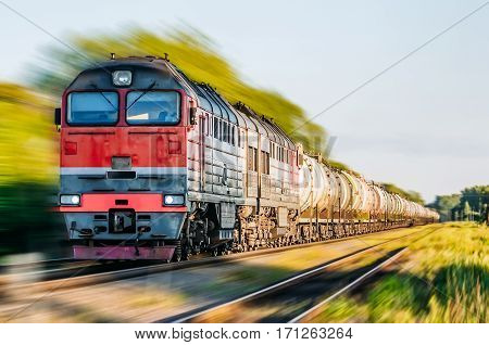 Freight train in motion speed rail station