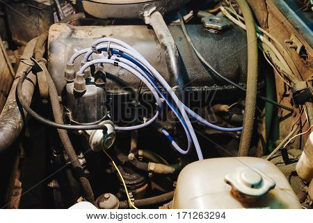 look under the hood of the car the engine compartment