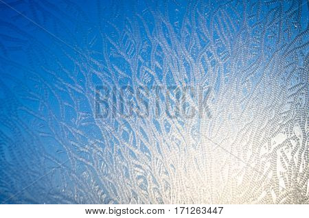 Frost ice pattern on glass winter frost