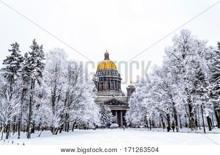 The dome of St. Isaac's Palace at sunset and trees in hoarfrost
