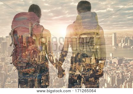 Double exposure of a couple in front of New York city