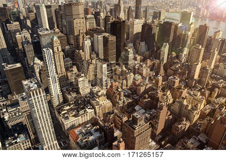 New York city close up on buildings and sunset in background. Aerial view