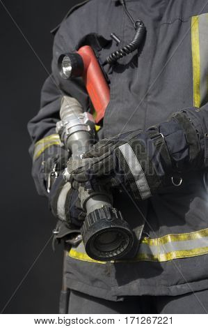 close image of firefighter holding fire hose
