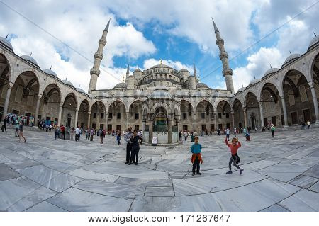 ISTANBUL TURKEY - JUNE 19 2015: People visiting Sultan Ahmet Mosque (Turkish: Sultan Ahmet Camii) a historic mosque in Istanbul Turkey. The mosque is popularly known as the Blue Mosque for the blue tiles adorning the walls of its interior