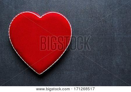 Velvet heart shaped box on a black chalkboard background