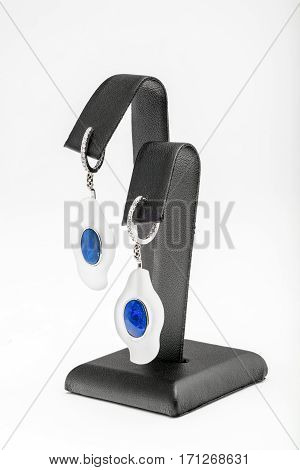 Jewelry, earrings on your ears with white and blue stone