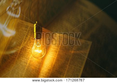 electric bulb illuminating a book for background