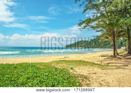 Deserted coast in a sunny day on blue sky background with white clouds