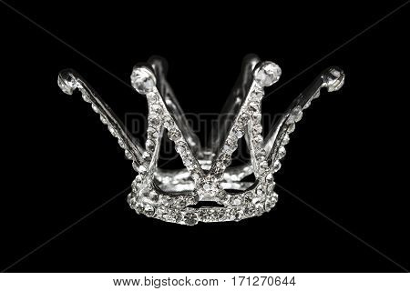 Crown with diamonds and crystals isolated over black