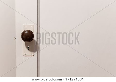 old wooden door with door knob close up.