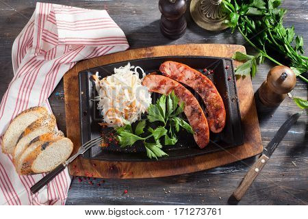 German sausage with cabbage, parsley Still top board, grill