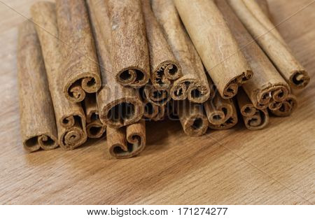 Fresh fragrance cinnamon sticks on brown wooden background