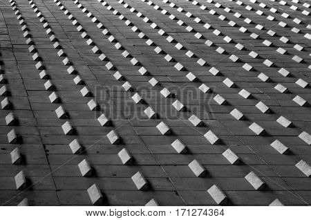 Black and white abstract geometrical pattern. Rhythmic pattern background from concrete blocks