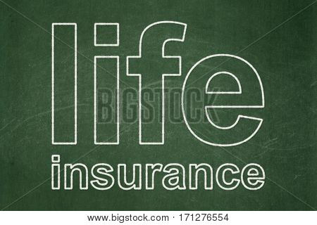 Insurance concept: text Life Insurance on Green chalkboard background