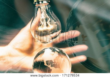 Light bulb and earth concept of global issues