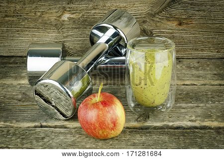 The concept of weight loss, Green smoothie and apple
