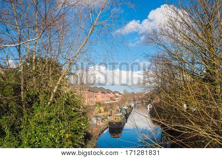 VIew of Birmingham Canal on a Sunny day showing some canal boats.