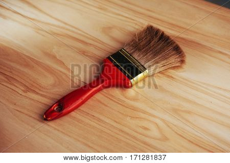 Brush isolated on wooden board wooden table.