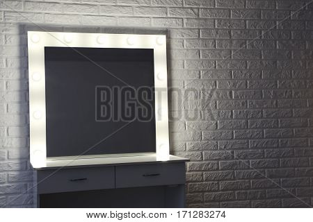 Makeup Mirror With Lightbulbs On Brick Wall Background