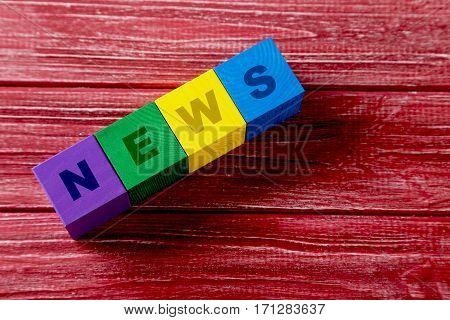 Colorful Wooden Toy Cubes On A Red Wooden Background