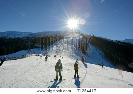 JASNA SLOVAKIA - JANUARY 22: The skiers snowborders and cableway in Jasna Low Tatras. It is the largest ski resort in Slovakia with 49 km of pistes on January 22 2017 in Jasna Slovakia