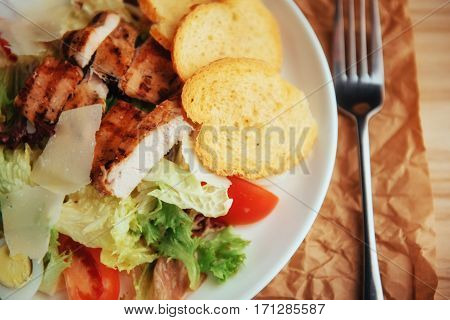 Caesar salad with croutons, quail eggs, cherry tomatoes and grilled chicken.