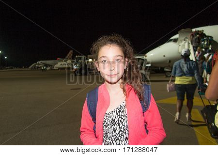 Girl Takes The Plane To Return Home After The Holidays In The Sun Of The Tropics