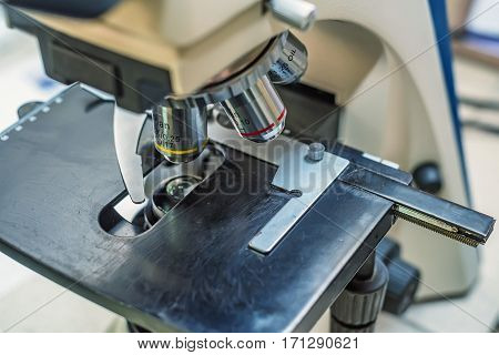 Close-up and soft focus of objective lens microscope in laboratory of veterinary clinic