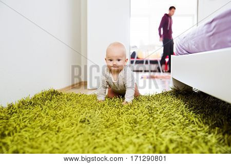 Portrait Of A Happy Cute Baby Child At Home Interior.