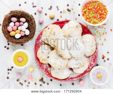 Easter cookies with chocolate candy eggs and colorful sugar sprinkles