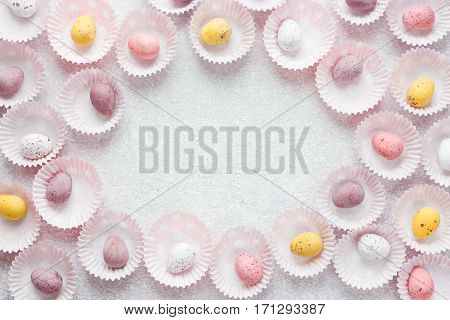 Chocolate speckled candy Easter eggs frame with space for text Easter egg background