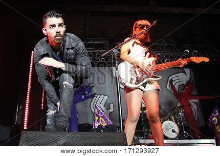 HUNTINGTON, NY-FEB 8: Joe Jonas (L) and JinJoo Lee of DNCE performs onstage at the Paramount on February 8, 2017 in Huntington, New York.