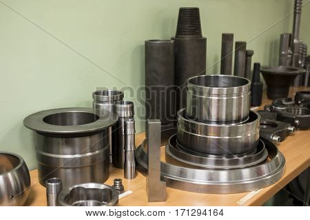 Industrial lathe tool and high precision cnc turning parts. high precision automotive machining mold and die part. CNC prosessed parts on table.