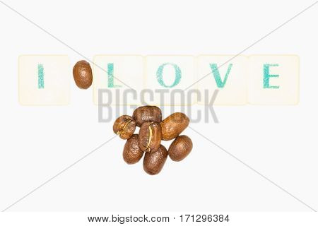 Inspirational Quote About Coffee Compose With Green Letters And Coffee Beans On A White Background