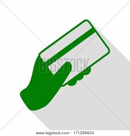Hand holding a credit card. Green icon with flat style shadow path.