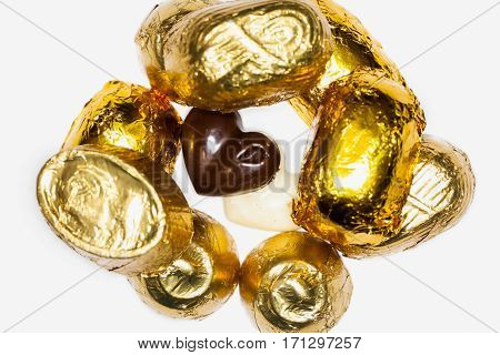 Close Up Of Chocolate Pieces Covered With Golden Aluminum Foil