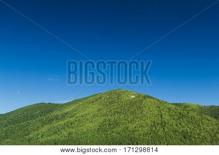 Beautiful green mountains in the summer sky