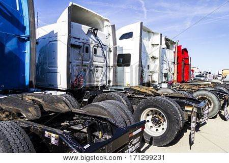 Indianapolis - Circa February 2017: Colorful Semi Tractor Trailer Trucks Lined up for Sale IV