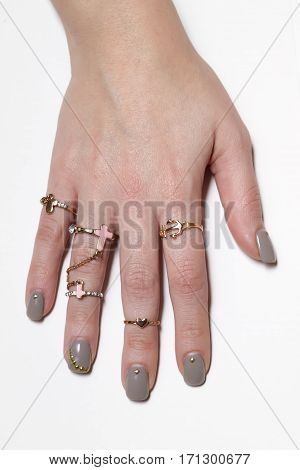 Various Gold Rings With Nice Manicured Fingernails.
