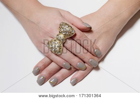 Big Beautiful Bow Ring With Nice Manicured Fingernails.
