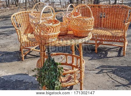 Trade of Handicrafts in the street in the spring. Wicker baskets and rattan furniture