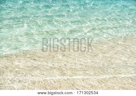 Beautiful marine view on sea coast line with clean wavy surf water on sandy beach at sunny day as natural background