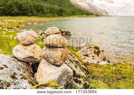 Stones Stack On Lake Shore, Norway