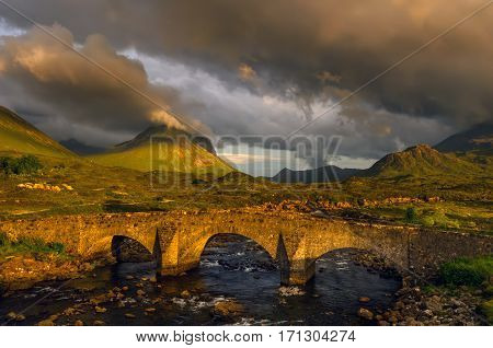 Old bridge in Glen Sligachan in cloudy sunset Isle of Skye Scotland