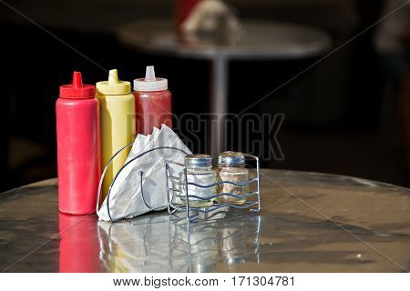 Condiments and napkins on the table in the street cafe Russia.