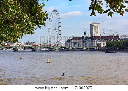 LONDON/ ENGLAND - AUGUST, 31. County Hall and  Ferris wheel London eye from the north bank of the River Thames on August 31, 2016 in Westminster, London, England.