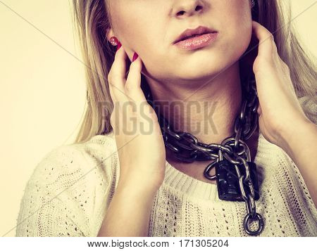 Sore throat tonsillitis health problems lack of freedom concept. Woman having metal chain around neck